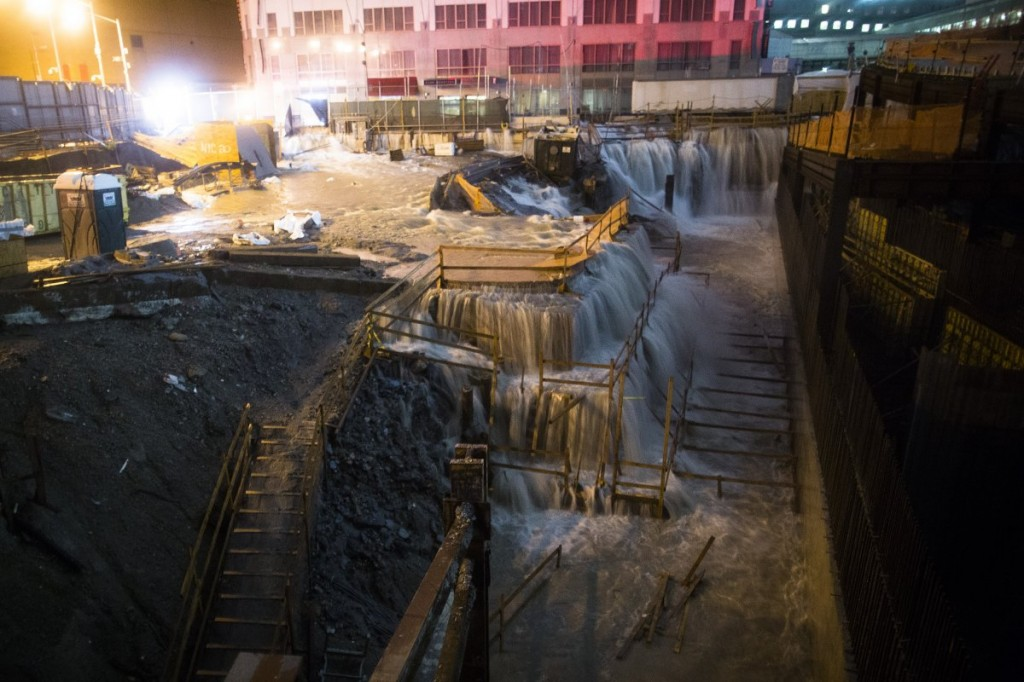 Water floods the ground zero construction site during 2012 superstorm Sandy