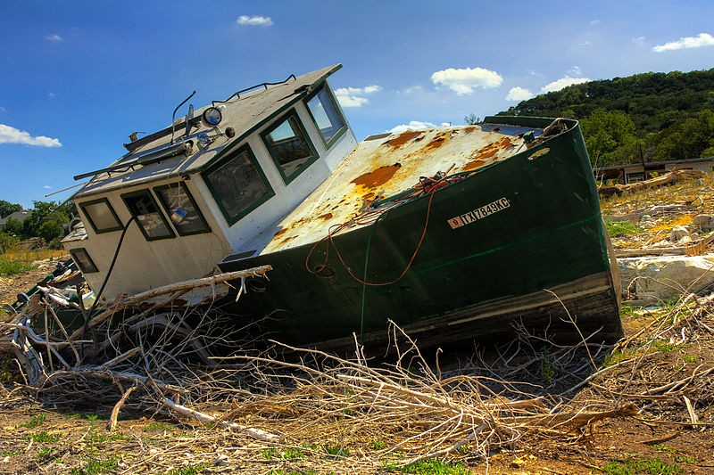 The 2011 drought dried up most of Central Texas water ways. This boat was left to sit in the middle of what is normally a branch of Lake Travis, part of the Colorado River.