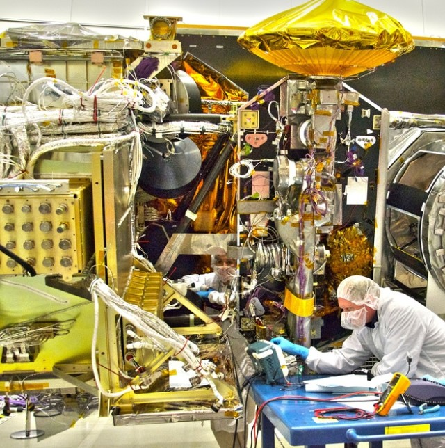 NASA engineers work on the Global Precipitation Measurement mission's Core satellite in the clean room at the Goddard Space Flight Center in Greenbelt, Maryland.